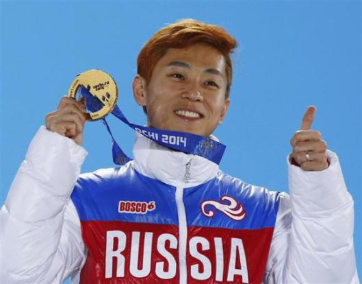 Victor An during victory ceremony for men's 1,000 metres short track speed skating finals at 2014 Sochi Winter Olympics